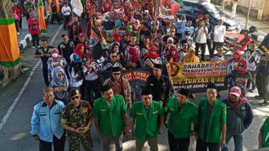 Photo of Ribuan Masyarakat Turun Jalan Dukung Kapolres Tuntaskan Kejahatan Bisnis Skema Piramida Oleh PT Q- NET